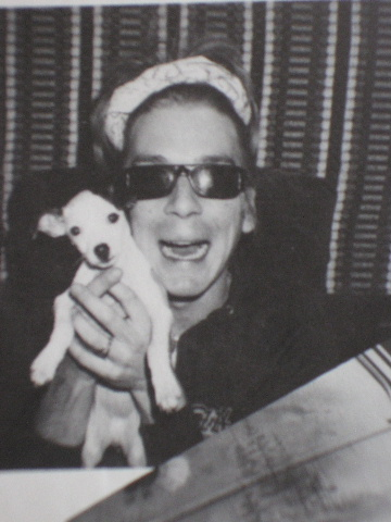 Randy with his pet dog..jpg